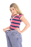 Mujer feliz de la pérdida de peso Fotografía de archivo libre de regalías