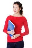 Mujer feliz del estudiante con el cuaderno Imagen de archivo
