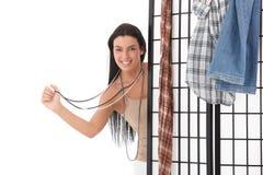 Mujer feliz detrás de vestir el panel Imágenes de archivo libres de regalías