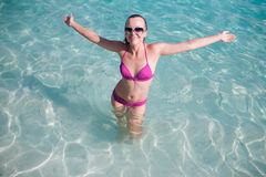 Mujer feliz en el agua Fotografía de archivo libre de regalías