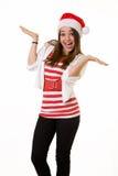 Mujer feliz en el sombrero de Santa imagen de archivo libre de regalías