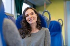 Mujer feliz en el tren imagenes de archivo