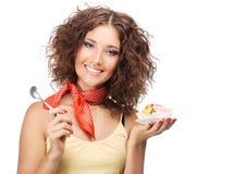 Mujer feliz hermosa con una torta de la jalea Imagenes de archivo
