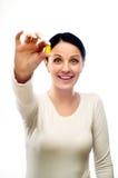 Mujer feliz joven con la cápsula Imagen de archivo