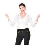 Mujer feliz con las manos aumentadas para arriba en la camisa blanca Foto de archivo libre de regalías