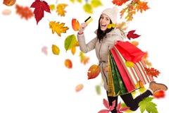 Mujer feliz joven con los bolsos de compras Imagen de archivo libre de regalías