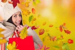 Mujer feliz joven con los bolsos de compras Imagenes de archivo