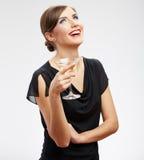 Mujer feliz joven en vestido negro con el vidrio Imagenes de archivo