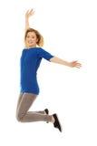 Mujer feliz joven que salta en el aire Fotografía de archivo libre de regalías