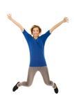 Mujer feliz joven que salta en el aire Imágenes de archivo libres de regalías