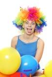 Mujer feliz loca con el pelo coloreado sobre blanco Imagen de archivo libre de regalías