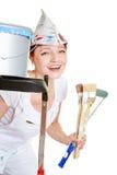 Mujer feliz mientras que pinta Imagen de archivo