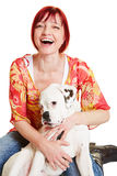 Mujer feliz con el perro joven del boxeador Fotos de archivo libres de regalías