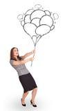 Mujer feliz que celebra el drenaje de los globos Fotografía de archivo libre de regalías