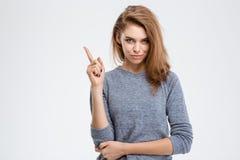 Mujer feliz que destaca el finger Imagenes de archivo