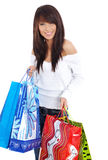 Mujer feliz que hace compras. Imágenes de archivo libres de regalías