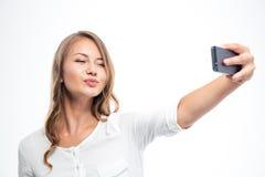 Mujer feliz que hace la foto del selfie Foto de archivo