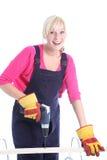 Mujer feliz que hace renovaciones de DIY Fotografía de archivo libre de regalías