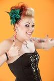 Mujer feliz que muestra los pulgares para arriba Foto de archivo libre de regalías