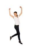 Mujer feliz que salta con las manos para arriba Imagenes de archivo