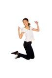 Mujer feliz que salta con los pulgares para arriba Fotografía de archivo