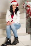 Mujer feliz que se sienta en las escaleras a casa Foto de archivo libre de regalías