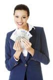Mujer feliz que sostiene el dinero euro Imagen de archivo libre de regalías