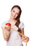 Mujer feliz sana con la manzana y la cinta métrica fotos de archivo libres de regalías