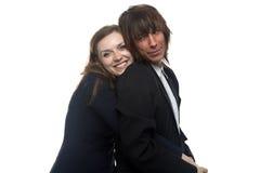 Mujer feliz y hombre serio en chaqueta negra Foto de archivo