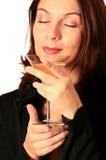 Mujer fina de la bebida Foto de archivo libre de regalías