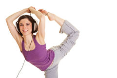 Mujer flexible con el auricular Foto de archivo libre de regalías
