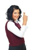 Mujer formal con los dedos cruzados Fotografía de archivo libre de regalías