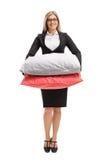 Mujer formalmente vestida con las almohadas imagen de archivo libre de regalías