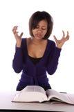 Mujer frustrada con el libro Foto de archivo libre de regalías