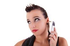 Mujer hermosa aburrida en el teléfono Fotos de archivo
