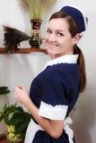 Mujer hermosa con barrido de limpieza Foto de archivo libre de regalías
