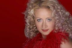 Mujer hermosa con el pelo rizado Fotos de archivo