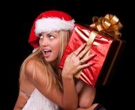 Mujer hermosa con el regalo del Año Nuevo Foto de archivo