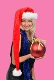 Mujer hermosa con el sombrero de Santa Fotos de archivo