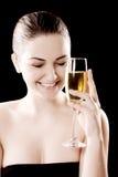 Mujer hermosa con el vidrio del champán Imagen de archivo