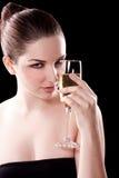 Mujer hermosa con el vidrio del champán Foto de archivo libre de regalías