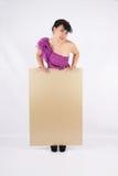 Mujer hermosa con la cartelera Foto de archivo
