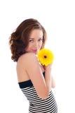 Mujer hermosa con la flor Foto de archivo