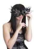 Mujer hermosa con la máscara y dedo cerca de los labios Imágenes de archivo libres de regalías