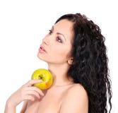 Mujer hermosa con la manzana imagen de archivo