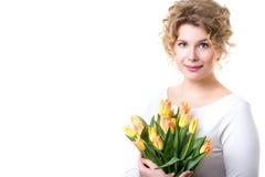 Mujer hermosa con las flores foto de archivo