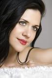 Mujer hermosa con los ojos de fascinación Imagen de archivo