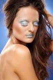 Mujer hermosa con maquillaje de la fantasía Fotos de archivo libres de regalías