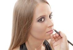 Mujer hermosa con maquillaje de la tarde Foto de archivo libre de regalías