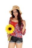 Mujer hermosa con un girasol Fotos de archivo libres de regalías